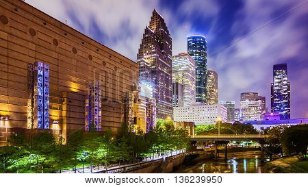 Houston, Texas downtown cityscape at night as the lights come on