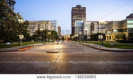 Street in downtown Baton Rouge Louisiana as night falls - skyline