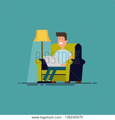 Man sitting in chair with laptop . Freelancer work at home