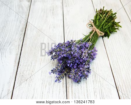 bunch of lavender on a old wooden table