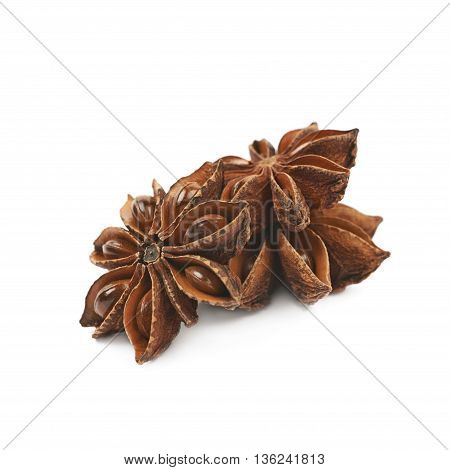 Pile of multiple Chinese star anise seeds, composition isolated over the white background