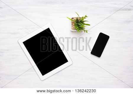 Top View Of Tablet Computer And Smartphone On Wooden Table.