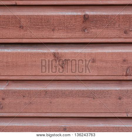 Close-up fragment of a wall made of an old painted wooden planks as a background texture composition