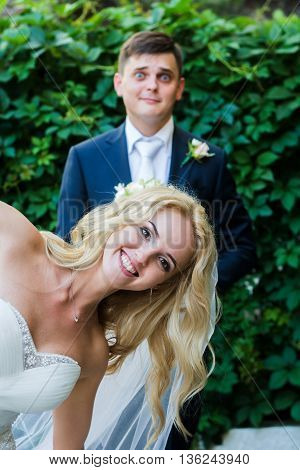 The Bride And Groom Having Fun In Nature