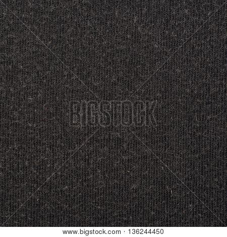Fragment of a black cloth fabric material texture as an abstract background composition