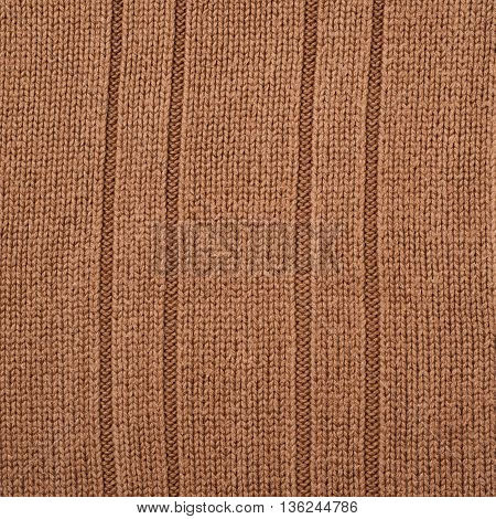 Fragment of a striped brown cloth fabric material texture as an abstract background composition