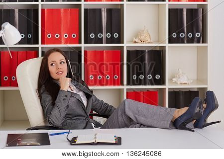 Young business woman is resting in workplace in the office. Break.