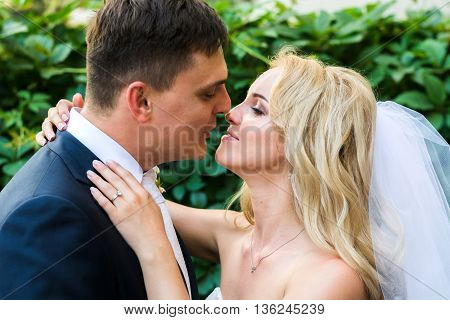 The Bride And Groom Kiss At The Camera