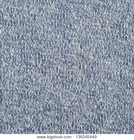 Fragment of a blue knitted cloth fabric material texture as an abstract background composition