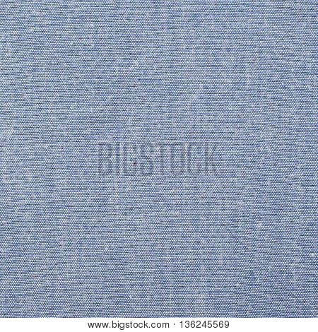 Fragment of a blue cloth fabric material texture as an abstract background composition