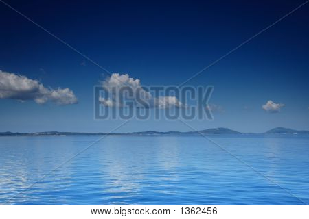 View Of An Open Sea With A Cloud On Corfu Island