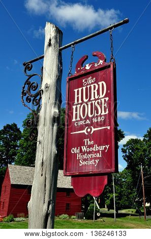 Woodbury Connecticut - September 15 2014: Wooden signpost at the circa 1680 Hurd House headquarters of the Old Woodbury Historical Society