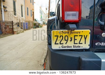 JERSEY CITY, NJ - CIRCA MARCH, 2016: close up shot of vehicle registration plate. It is a metal or plastic plate attached to a motor vehicle or trailer for official identification purposes.