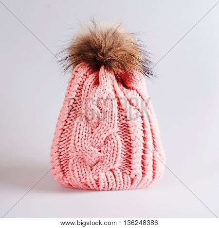 pink Knitted hat with bubo over grey