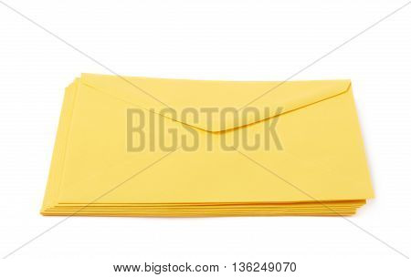 Stack of multiple yellow letter envelopes isolated over the white background