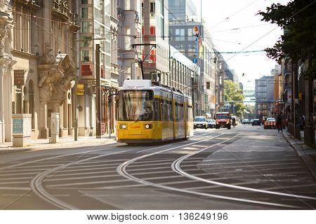 Berlin Germany - June 26 2016: Yellow tram in Berlin Mitte Germany. Tramway public transport