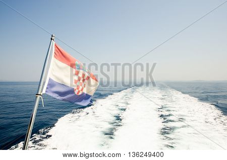 Croatian flag at sea on the back of the yacht