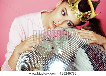 young cute disco girl on pink background with disco ball and crown smiling adorable emotions