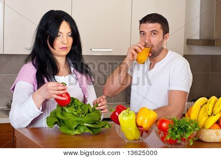 Mid Adult Couple In Kitchen