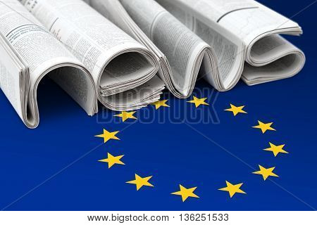 Stacks of modern newspapers composed in form of word NEWS on EU flag background