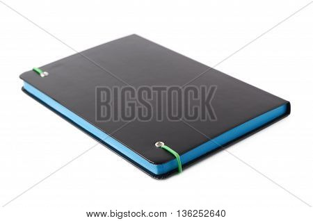 Black closed note book isolated over the white background