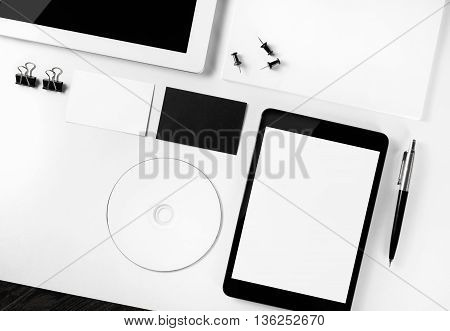 Photo of blank stationery set and corporate identity template on paper background. Responsive design template. Mock-up for your design. Top view.