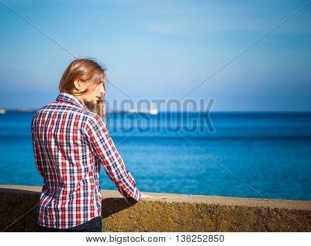 Man Long Hair Relaxing By Seaside