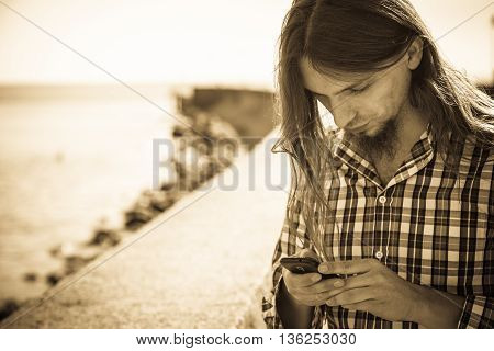 Man Outdoor Using Cell Phone