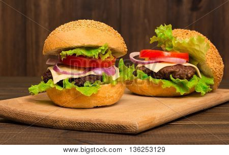 Homemade burger beef on the wooden table