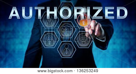 Business manager is touching AUTHORIZED on an interactive virtual control screen. Business metaphor and information technology concept for management of computer and network access control.