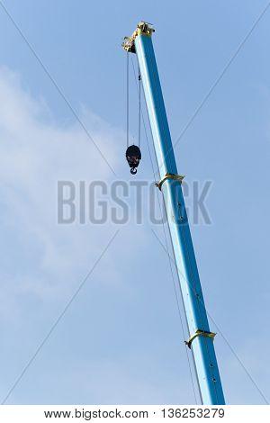 High crane under the light blue and cloudy sky
