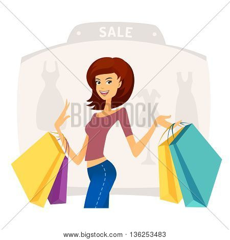 Happy beautiful young woman with shopping bags in shopping mall