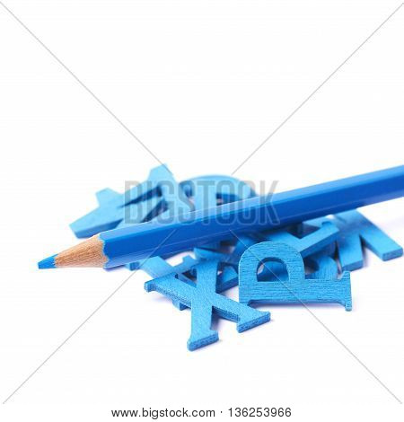 Pile of painted wooden letters with the drawing pencil over it, composition isolated over the white background