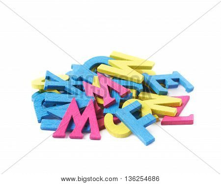 Pile of colorful painted wooden letters isolated over the white background