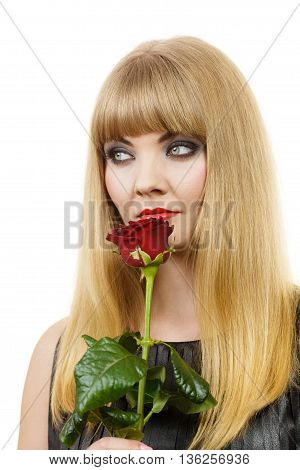 Woman holding rose flower. Attractive blonde lady dark makeup studio shot isolated on white. Beauty holidays celebration concept
