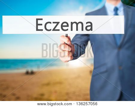 Eczema - Businessman Hand Holding Sign