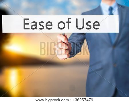 Ease Of Use - Businessman Hand Holding Sign