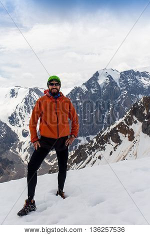 Man hiker on a top of a mountain in Altay, Russia