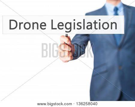 Drone Legislation - Businessman Hand Holding Sign
