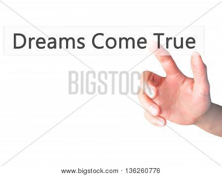Dreams Come True - Hand Pressing A Button On Blurred Background Concept On Visual Screen.