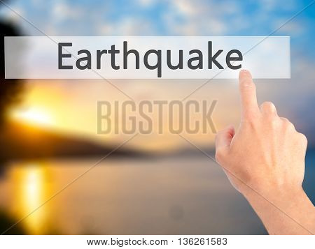 Earthquake - Hand Pressing A Button On Blurred Background Concept On Visual Screen.