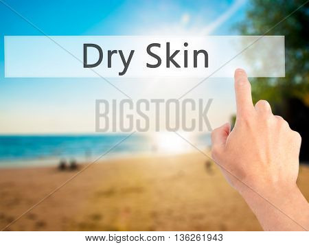 Dry Skin - Hand Pressing A Button On Blurred Background Concept On Visual Screen.