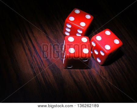 Dice, game table for entertainment, betting and leisure.