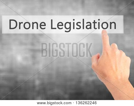 Drone Legislation - Hand Pressing A Button On Blurred Background Concept On Visual Screen.