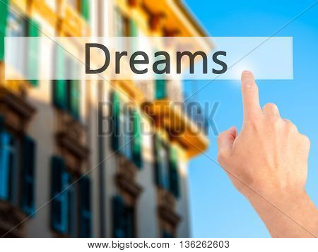 Dreams - Hand Pressing A Button On Blurred Background Concept On Visual Screen.