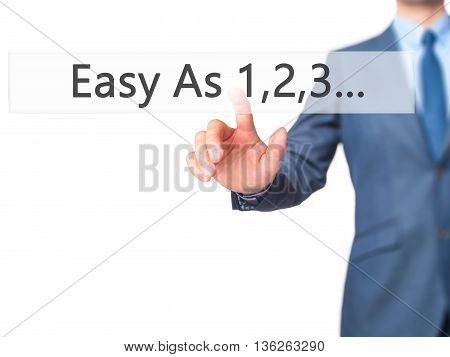 Easy As 1,2,3... - Businessman Hand Pressing Button On Touch Screen Interface.