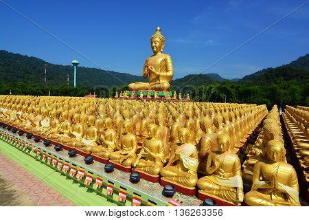 Many golden buddha statues at Buddha Makabucha Memorial park Nakornnayok Thailand