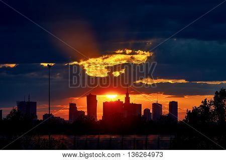 Warsaw, Poland - May 04, 2016: Sunset in the center of Warsaw, Poland with silhouettes of Palace of Culture and Science - PKiN - Palac Kultury i Nauki - and skyscrapers.