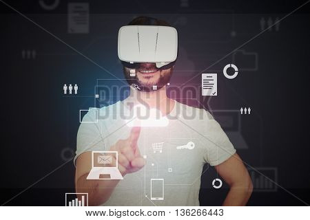 Young bearded man in 3d virtual reality glasses is using modern virtual touch screen technology