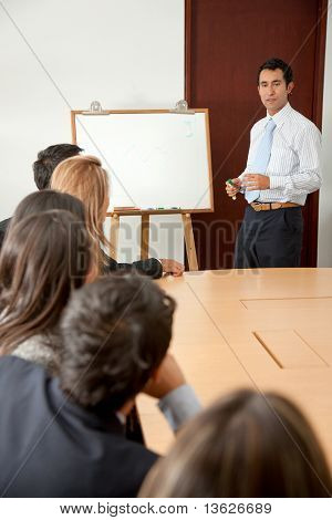 Business man doing a presentation at the conference room